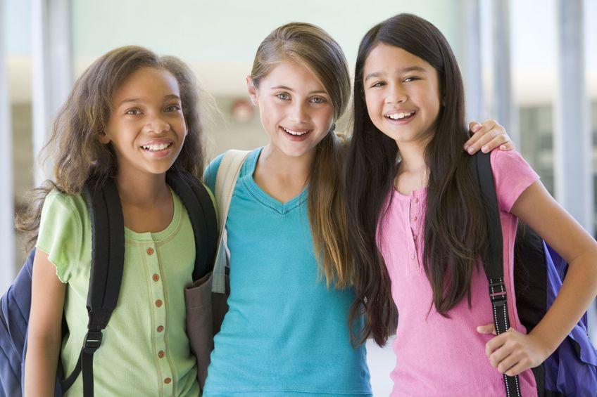 three preteen girls
