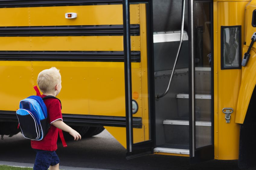 little boy safety getting on school bus