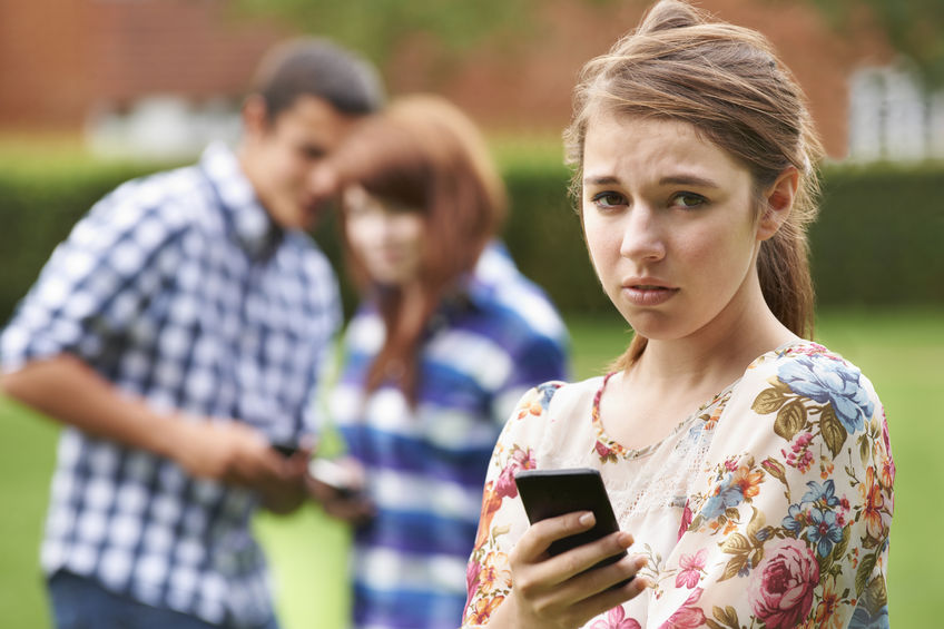49295771 - teenage girl victim of bullying by text messaging